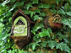 Fairy door and window attached to tree
