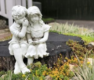 A Fairy Garden with Plants Stump Statue