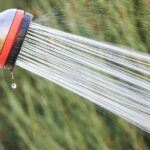 water spraying from hose
