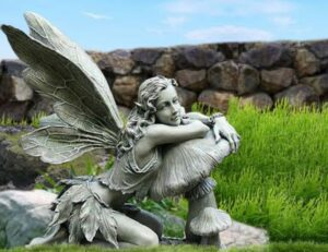 Beautiful Fairy Leaning on Mushroom Statue