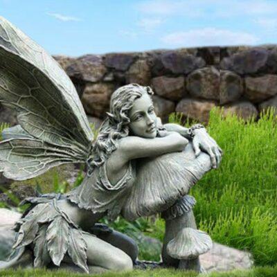 Beautiful Fairy Leaning on Mushroom Statue